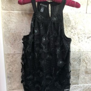 INC black Size M top with sequins and flowers